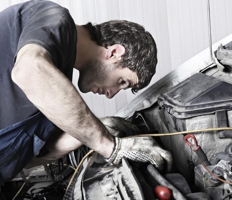 road-trip-check-mechanic-under-hood